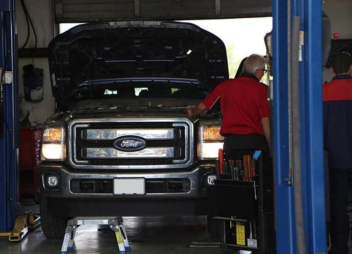 Christian Repairing pick-up truck
